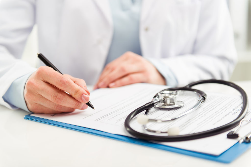 Physician signing a contract